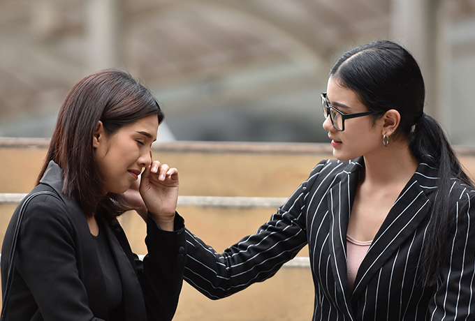Women comforting her friend talking about suicide
