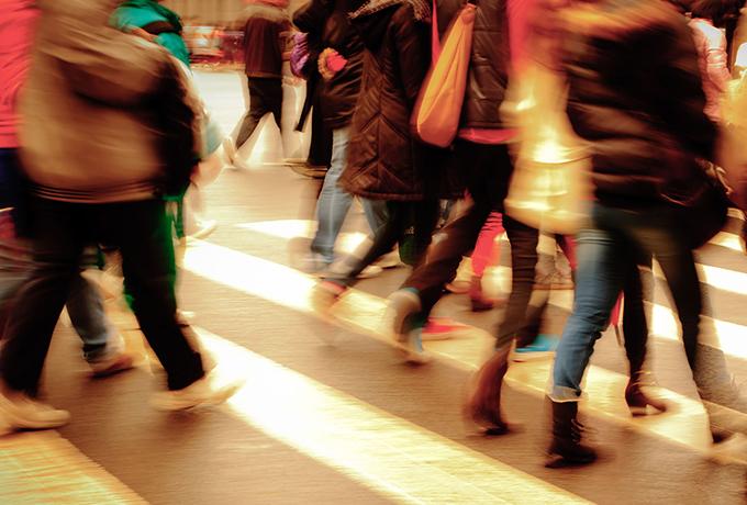 People walking along a busy street