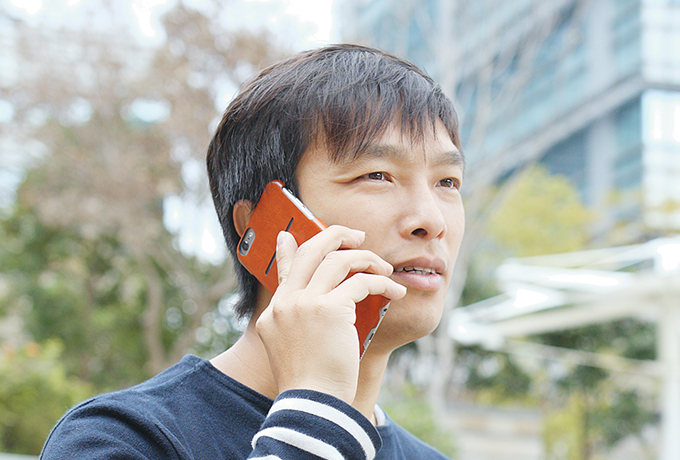 Man talking on a phone accessing phone and online counselling