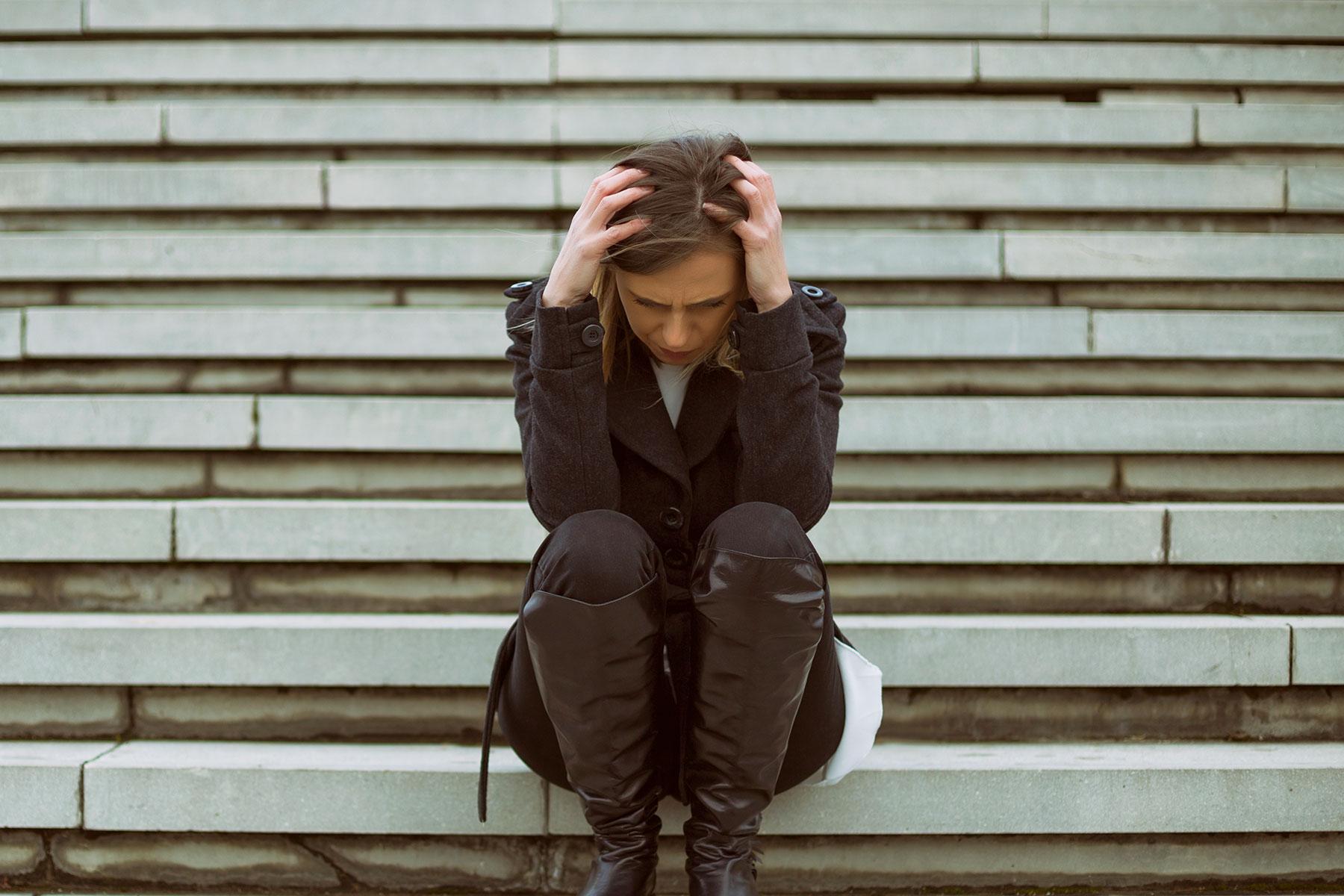 Women sitting on step upset