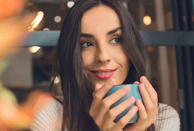 Image of a woman drinking coffee