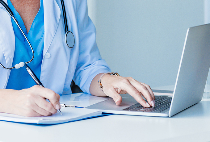 Health professional working on a laptop