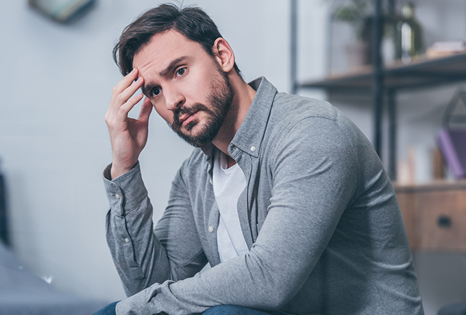 depressed man sat contemplating
