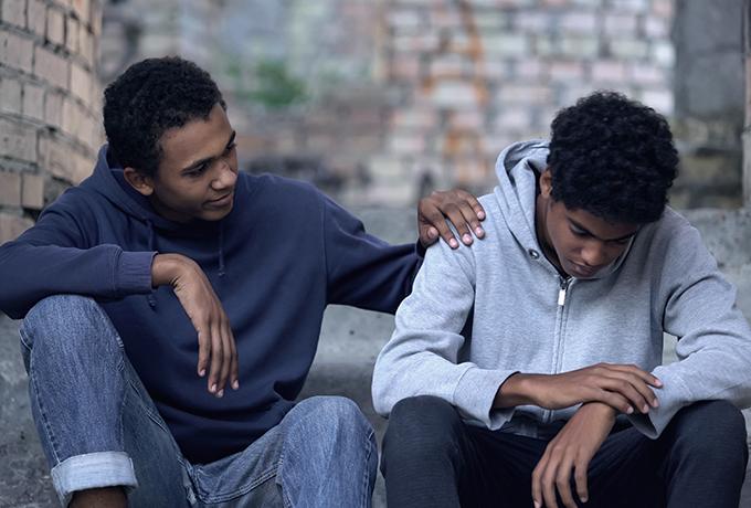 Two men sat talking