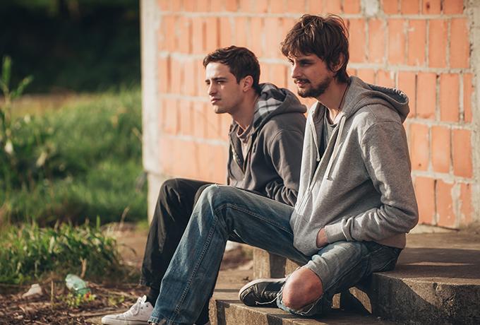 Two men sitting together talking